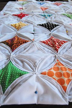 I'd LOVE a cathedral quilt like this for my bed. Mostly white with color windows