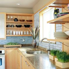 Kitchen-this looks cool. Light and cool, but still warm. I like the way they carried the granite into the window sill.