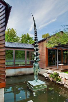 Modern Lakefront Residence Exterior With Wood Plank Siding And Fish Pond With Contemporary Sculpture Also Metal Shed Roof Design Ideas: Astonishing Lake House Design in Austin, The Lakefront Residence