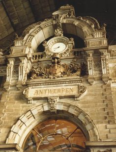 the clock/sign for Antwerp, Belgium.  Feb '92.  inside the train station.  last time i'd been here was '82 with Doug & Lorna.  hurry and scurry.  memories from that time as i, in '92 walked the streets.