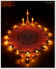 How we decorate on Diwali. Each house is decorated with lights, candles, diyas and  rangolis are designed by the entrance door.