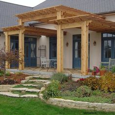 Tiered, entryway pergola designed and built with heavy timber. | more ideas at…