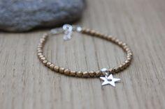 Bracelet en perles cristal de bohème doré mat et breloque étoile en argent  massif , bracelet