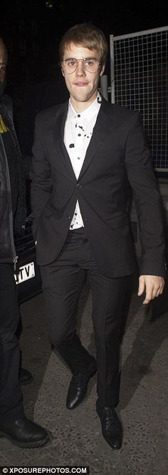 Transfomed: Bieber had arrived in a fitted black suit...