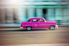 La Habana, Cuba hot pink vintage car captures motion color and light