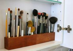 "DIY makeup brush holder, by Sabrina Soto. "" Sabrina bore holes in a piece of craft wood to accommodate all her makeup brushes in the medicine cabinet."