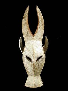Kwele Mask - carved from wood, painted with white kaolin Long pointed upright horns and ears