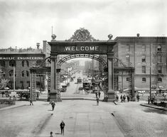 """Denver, Colorado, circa 1908. """"Welcome Arch at Union Depot looking down 17th Street."""" The arch, with the Hebrew benediction """"mizpah"""" soon replacing WELCOME on the other (departure) side, was torn down in 1931. Shorpy Historical Photo"""