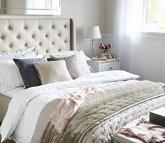 Home Inspiration Bedding Ideas, classic bedding look. Quilted upholstery bed with white bedding, velvet throw and cushions.