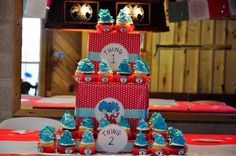 """Cupcake cake... to dress up any cupcakes! I just wrapped these with discount holiday paper and added ribbon and """"Thing 1, Thing 2"""" print-outs!"""