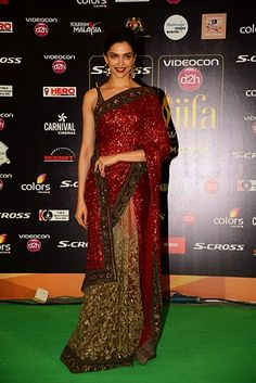 Deepika Padukone in Sabyasachi at IIFA 2015. Not many ppl would be able to carry so much shimmer in red. But who says Sabyasachi creates for the common woman? Description by Mahua Roy Chowdhury