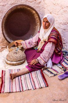 Berberian woman making bread by Luca Faoro