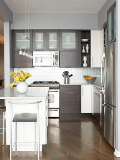 Material & Color Choices great choices, I like this kitchen becasue of the flow I love th cabinets with t frosted glass and the light fixtures bring everything together