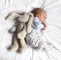baby boy and stuffed rabbit. Sleeping baby