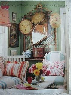 Bold use of color and the romantic, world-traveled look of her accessories. I believe a home's interior should read like a scrapbook of one's life and loves!! (thanks to Birdie Pearl blog)