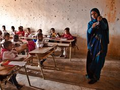 Saharawi schoolchildren undertaking a test. Most of the children here have never set foot outside their camp. The Sahrawi see education as an instrumental mean in fighting for their land, and some get to leave the camps to continue their education in Algeria.