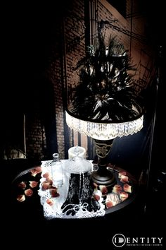 Prohibition inspired table top decor. Feathers, petals, lace, mirrors