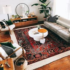 Love this eclectic modern boho living room, especially the rug (although I would go more terra cotta to blend with our home's colors)