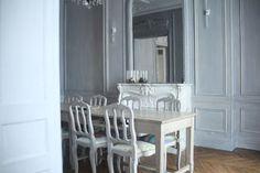 herringbone floors; paneled walls