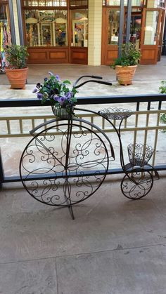 Found this pretty plant stand/bicycle