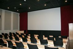 The cinema classroom in the Center for Cinematic Arts at Liberty University has a high end acoustical treatment using wall panels, acoustical curtains, insulation and speaker compartment made with Acoustone Grill Cloth!