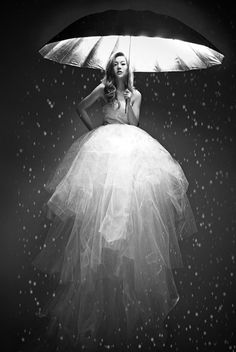 Lovely lady in poofy tulle wedding dress holding light umbrella. I'd frame it & hang it at home. <3
