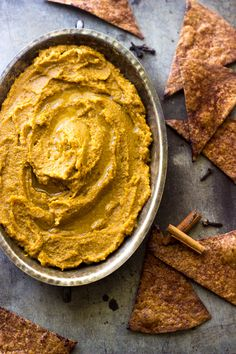 "This is the best Pumpkin Hummus recipe! Complete with Cinnamon ""sugar"" baked tortilla chips, you won't be able to stop eating it!"