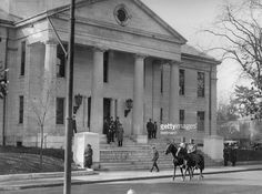 Guards wait outside of a courthouse during the trial proceedings of the Sacco-Vanzetti case.