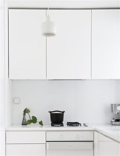 white modern kitchen. from time of the aquarius blog