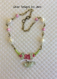 Birdie Necklace .. Iced Enamels was used on the flower and birdie stampings ..  vintage pearls, spectra beads, bead caps and brass chain complete this tweet necklace .. FOR SALE $35.00  .. https://www.etsy.com/shop/CleverDesignsbyJann