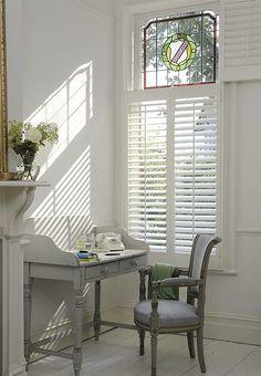 Window,shutters,chair.