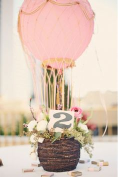 "DIY Hot Air Balloon Centerpieces. ""What a great centerpiece idea for weddings and baby showers, huh?"" Link has a tutorial. Wedding Ideas Table Setting Ideas Party Decorating Ideas Flower Arrangement Table Scapes"