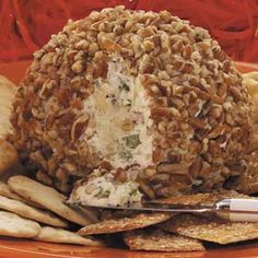 PINEAPPLE CHEESE BALL.  I prefer to Spread this in a shallow dish and top with pecans instead of rolling into a ball.  Delish