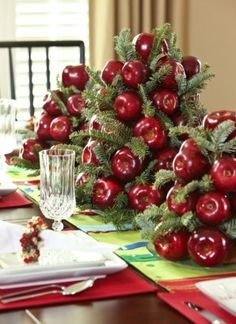 Cute way to construct an apple and pine bough centerpiece. Using styrofoam cones hot glue apples to form add in pine greenery with a u-shaped pin.
