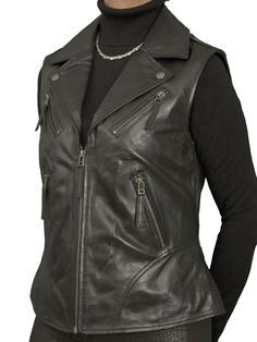Stylish and classy biker-style womens leather gilet in black soft lambskin nappa. Metal zips on front pockets and at back hem. Also in sky blue, mustard and wine red. Great for smart-casual wear with anything - leggings, trousers, jeans, shorts or skirt!