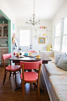 I love the window seating and pops of pink