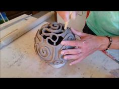 making raku pottery brain coral lamp.  product by: - FedericoBecchettiArt.etsy.com -  Handmade ceramic openwork lamp inspired by the shapes of the braincoral. The work consists of a spherical body perforated with sinuos spiral pattern. The video shows the Forming process; then it is soaked of ceramic glaze. you can find here: www.etsy.com/listing/208281684