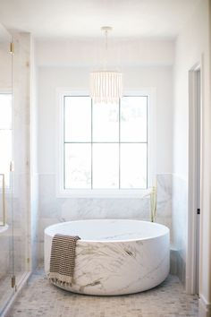 Marble Soaking Tub, Floor Mount Brass Faucet, Marble Master bathroom, Natural Wood Chandelier, All White Stone Bathtub, Interior, Home, Modern Bathroom Design, House Interior, Bathroom Interior, Bathtub Design, Bathroom Decor, Beautiful Bathrooms
