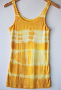 how to tie-dye a shirt naturally with turmeric (think about all the lightly stained white tees and tanks that could be dyed!)