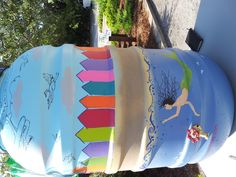 Rain barrel I painted for the 2012 New Smyrna Beach Water-Wise Garden Fair to represent Byrds Eye View Landscape ( byrdseyeviewlandscape.com )