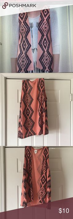 Aztec Printed Orange Vest Super fun Aztec vest! The material is really comfortable and it hugs the body really nicely. Only worn once or twice! Daytrip Jackets & Coats Vests