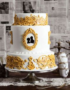 mustard yellow black cake by Amanda Oakleaf Cakes, via Flickr