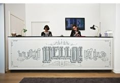 Large reception desk with fun typography