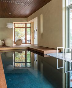 A 75-foot-long, single-lane lap pool is naturally lit by the floor to ceiling windows during the day. Inside Pool, Japanese Soaking Tubs, Pool Ladder, Roof Covering, Small Pools, Swimming Pools, Lap Pools, Indoor Pools, Backyard Pools