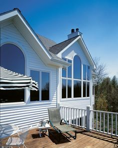 Large windows and bright white siding on a beautiful day | ClearView Window & Door Company
