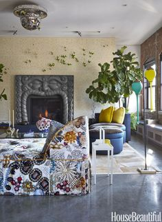 """Contemporary Fireplace Designer Harry Heissmann spun a New York City loft apartment into a contemporary fairy tale. He turned a """"postage stamp-size"""" fireplace into the living room's focal point with a large-scale, custom-made mantel.See more cozy fireplace ideas at HouseBeautiful.com."""