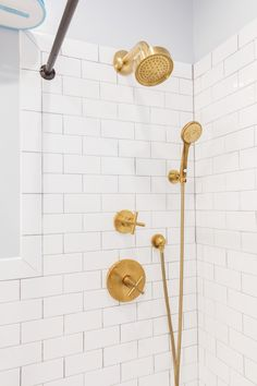 Daniel and Kate's bathroom remodel features gold shower fixtures that stand out against bright white subway tile. Single Handle Bathroom Faucet, Vessel Sink Bathroom, Widespread Bathroom Faucet, Bathroom Faucets, Bathroom Showers, Bathrooms, Brass Bathroom Fixtures, Shower Fixtures, Shower Faucet