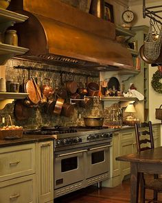 Paula Deen's Sprawling Savannah Mansion Is for Sale. The cook's kitchen is outfitted with a Viking range and a broad copper hood. Restaurant Chalet, Cottage Restaurant, Kitchen Stove, Copper Kitchen, New Kitchen, Kitchen Pics, Rustic Kitchen, Kitchen Ideas, Kitchen Cabinets