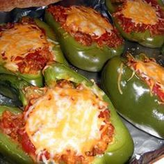 Peppers stuffed with rice, ground beef, and spices, and topped with glorious cheese.