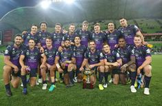 Cameron Smith and the Melbourne Storm celebrate with the Michael Moore trophy after winning the round eight Anzac Day NRL match between the Melbourne Storm and the New Zealand Warriors at AAMI Park on April 25, 2017 in Melbourne, Australia.